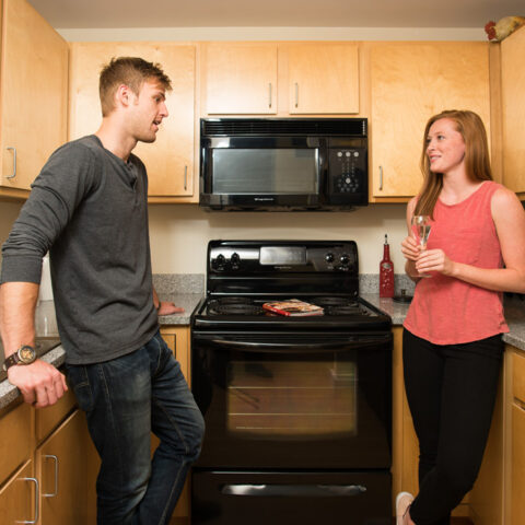 couple talking in kitchen of apartments in wilmington de
