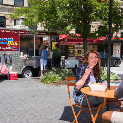 couple eating at food truck near apartments in wilmington de