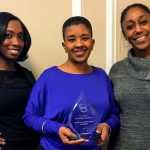 Residences at Rodney Square employees accepting an award