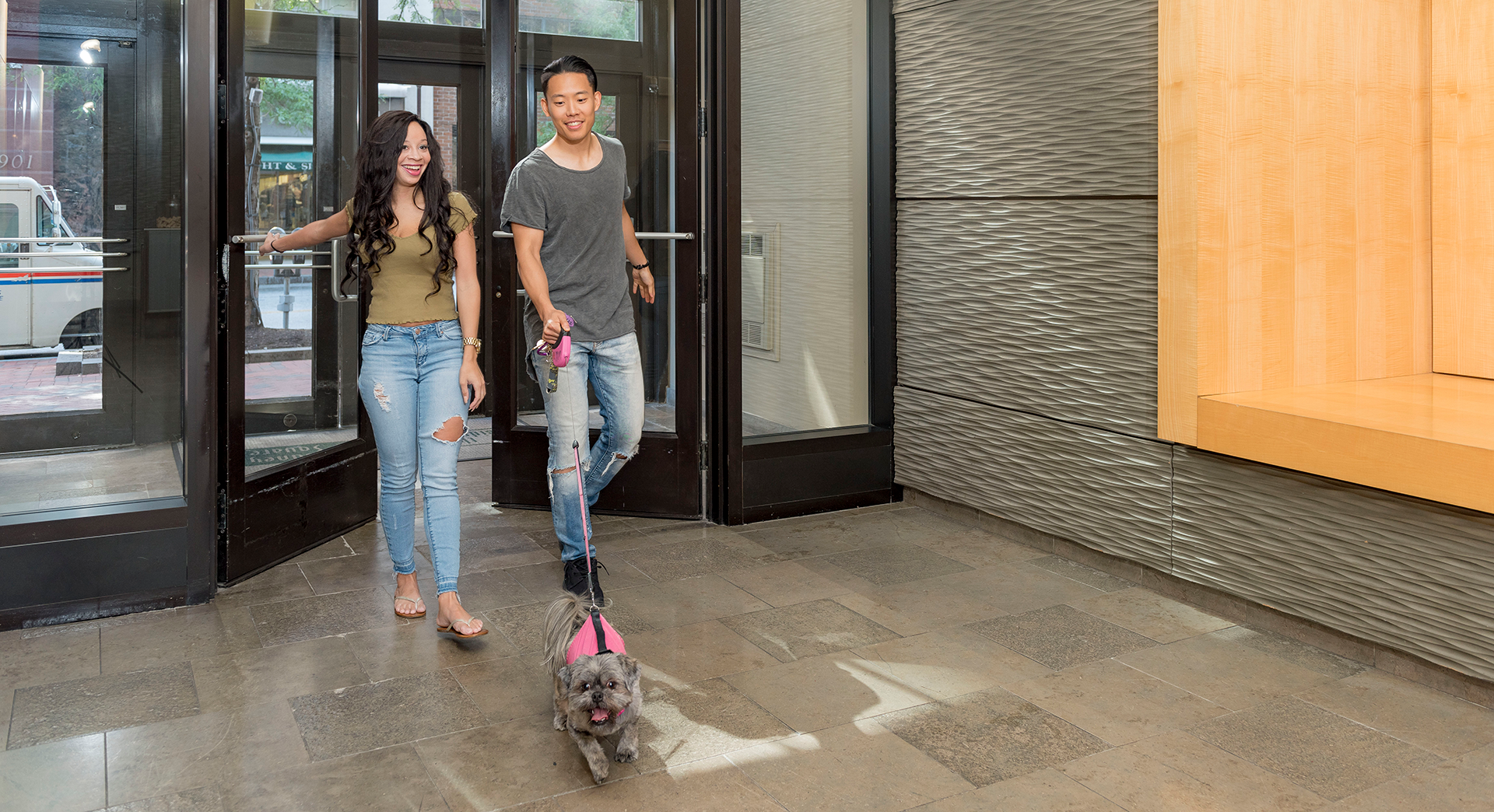 couple walking dog at pet-friendly apartment in Wilmington, DE