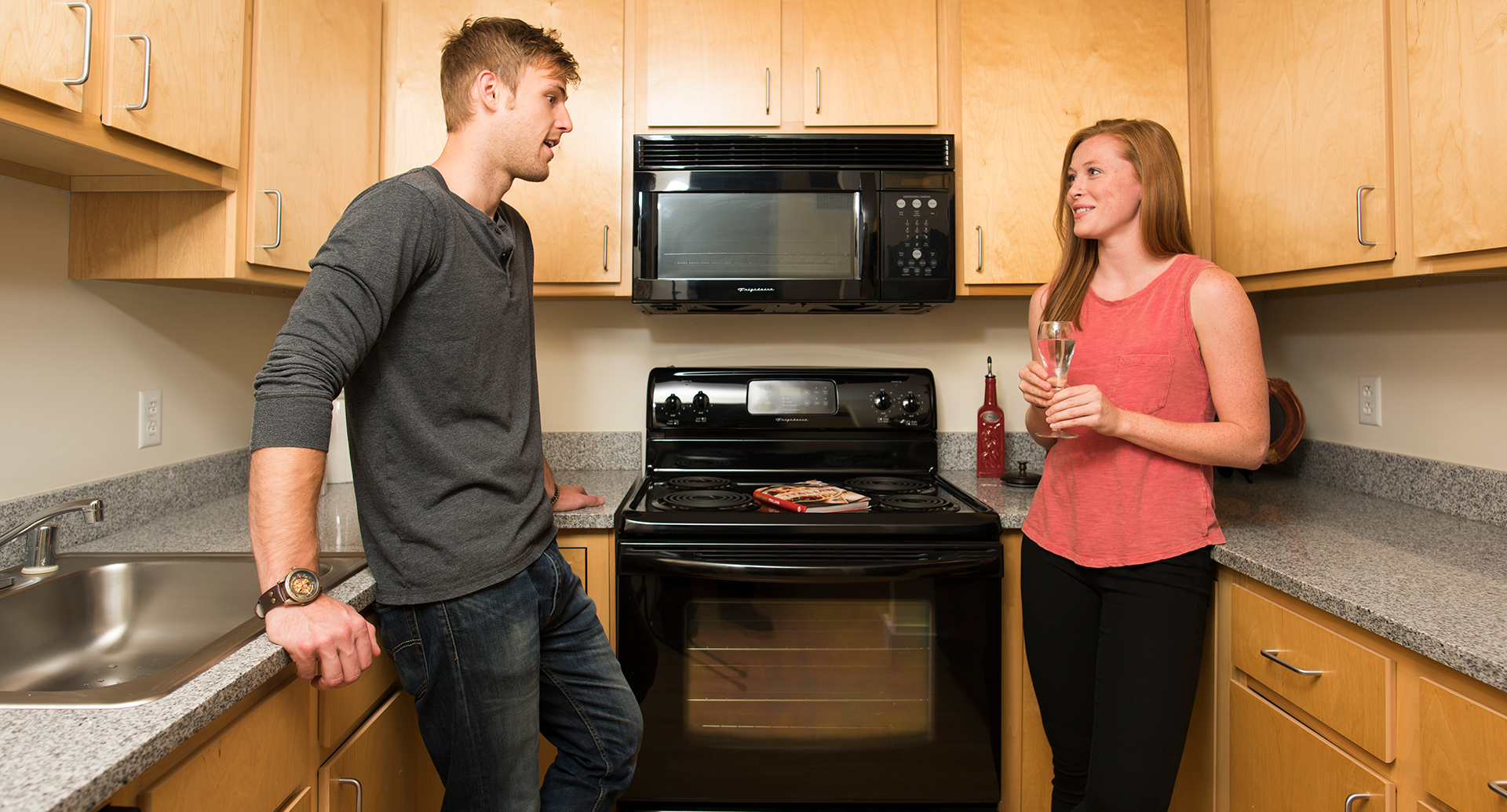 Residents in the kitchen in Downtown Wilmington, DE apartments